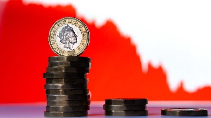 La libra esterlina se desploma por la caída histórica de la economía de Reino Unido